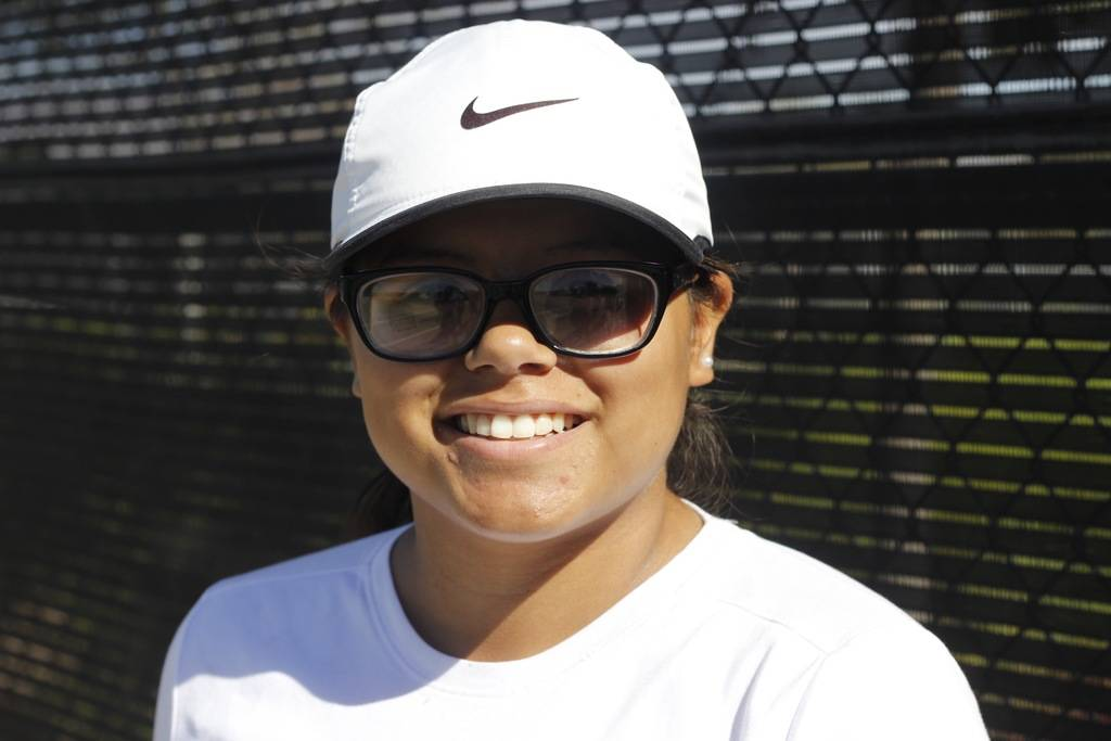 "Veronica Palacios, 18, is Coach George Cantu's assistant for tennis lessons at Craig Ranch Regional Park every Saturday from 11-2. ""I wanted to give back to the kids,"" Palacios said of her positi ..."
