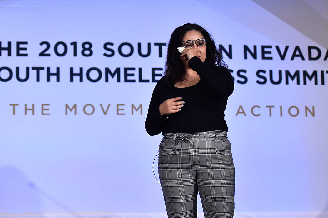 Dessirae Mitchell wipes a tear as she shares her story of homelessness during the Southern Nevada Youth Homelessness Summit at the Venetian Las Vegas Friday, Nov. 2, 2018, in Las Vegas. Nevada Par ...