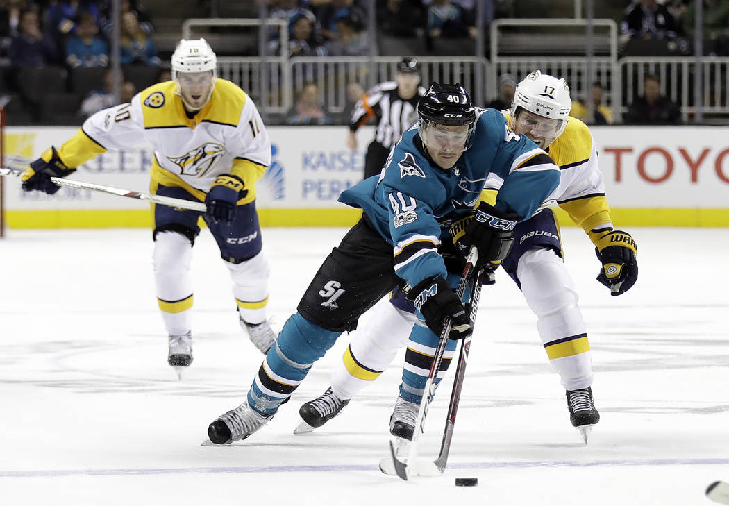San Jose Sharks' Ryan Carpenter (40) is defended by Nashville Predators' Scott Hartnell (17) during the second period of an NHL hockey game Wednesday, Nov. 1, 2017, in San Jose , Calif. (AP Photo/ ...