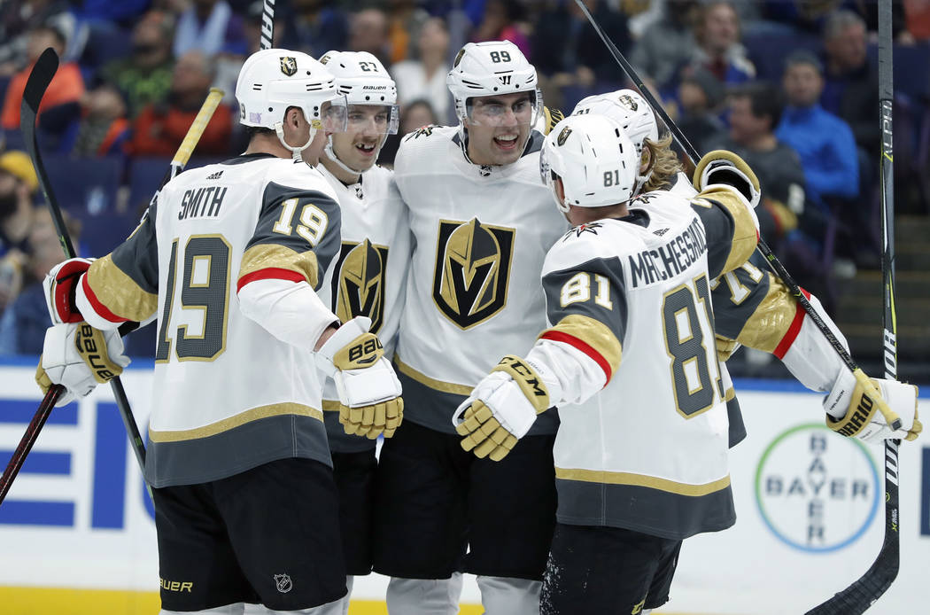 Vegas Golden Knights' Alex Tuch (89) is congratulated by teammates after scoring during the third period of an NHL hockey game against the St. Louis Blues Thursday, Nov. 1, 2018, in St. Louis. The ...