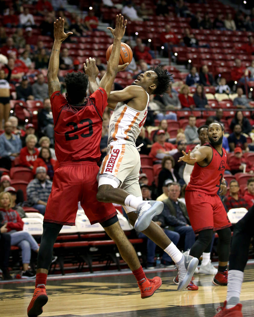 UNLV Rebels forward Joel Ntambwe (24) shoots over Southern Utah Thunderbirds guard Cameron Oluyitan (23) in the first half of their NCAA basketball game at the Thomas & Mack Center in Las Vega ...