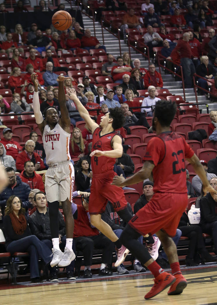 UNLV Rebels guard Kris Clyburn (1) shoots over Southern Utah Thunderbirds guard Dre Marin (4) in the first half of their NCAA basketball game at the Thomas & Mack Center in Las Vegas Friday, N ...