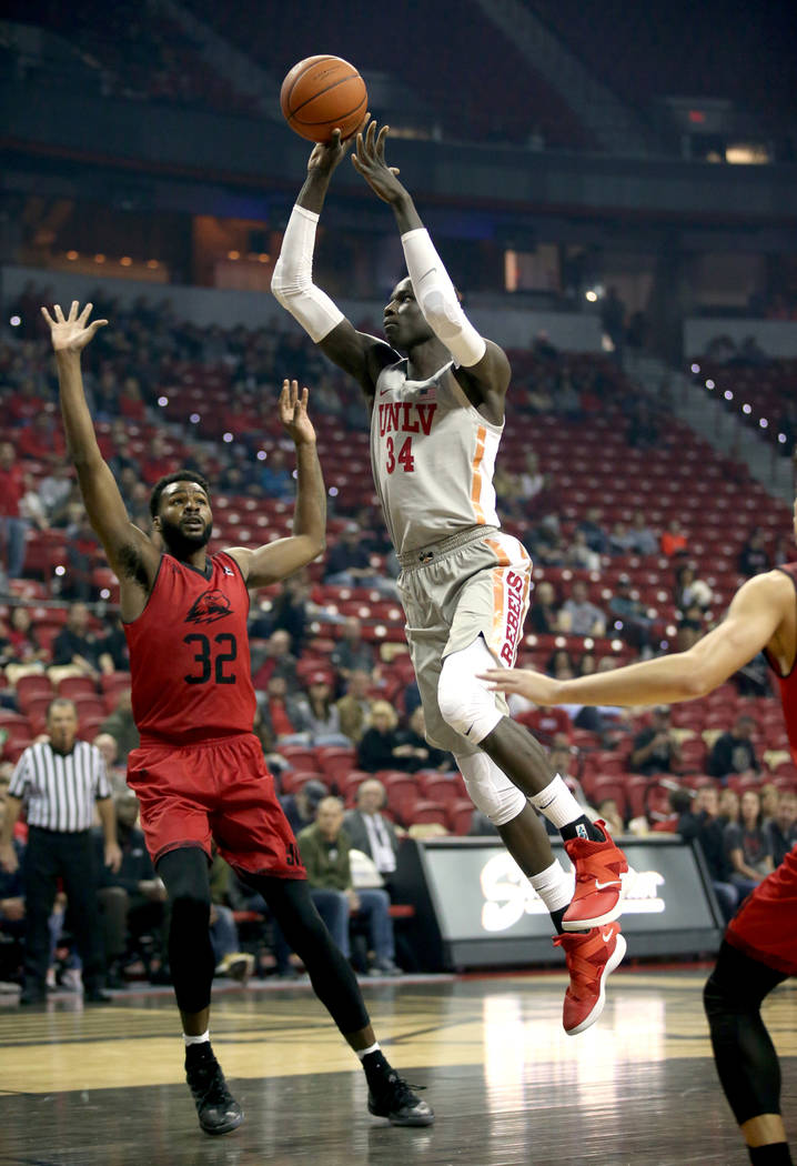 UNLV Rebels forward Cheikh Mbacke Diong (34) shoots past Southern Utah Thunderbirds forward Andre Adams (32) in the first half of their NCAA basketball game at the Thomas & Mack Center in Las ...