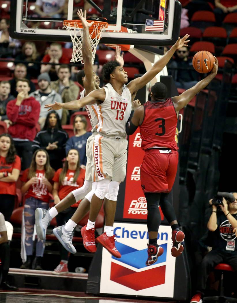 UNLV Rebels guard Bryce Hamilton (13) blocks a shot by Southern Utah Thunderbirds guard Jason Richardson (3) in the first half of their NCAA basketball game at the Thomas & Mack Center in Las ...