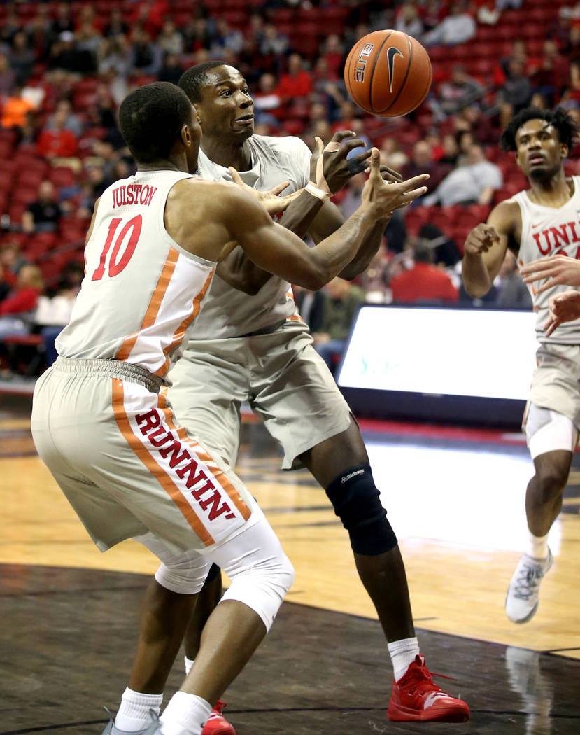 UNLV Rebels forward Shakur Juiston (10) and forward Cheickna Dembele (15) go for a loose ball in the second half of their NCAA basketball game at the Thomas & Mack Center in Las Vegas Friday, ...