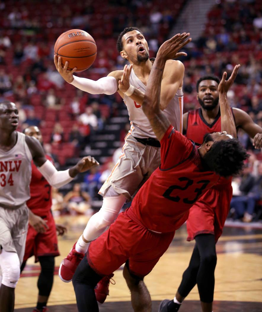 UNLV Rebels guard Noah Robotham (5) fouls Southern Utah Thunderbirds guard Cameron Oluyitan (23) in the second half of their NCAA basketball game at the Thomas & Mack Center in Las Vegas Frida ...