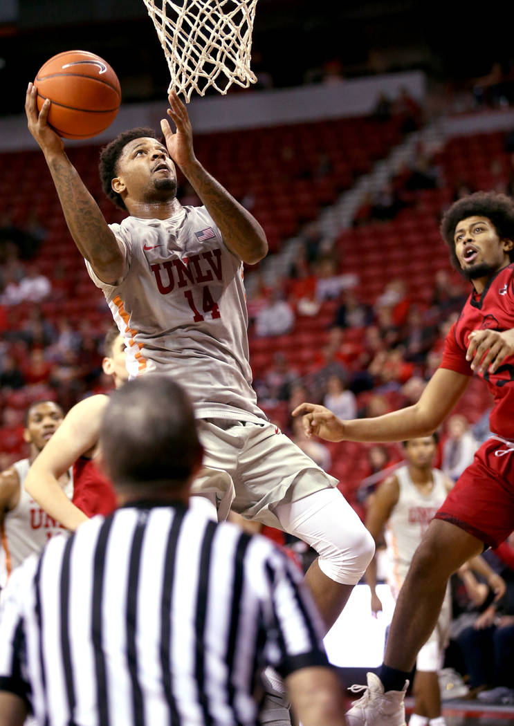 UNLV Rebels forward Tervell Beck (14) shoots in the second half of their NCAA basketball game at the Thomas & Mack Center in Las Vegas Friday, Nov. 23, 2018. K.M. Cannon Las Vegas Review-Journ ...