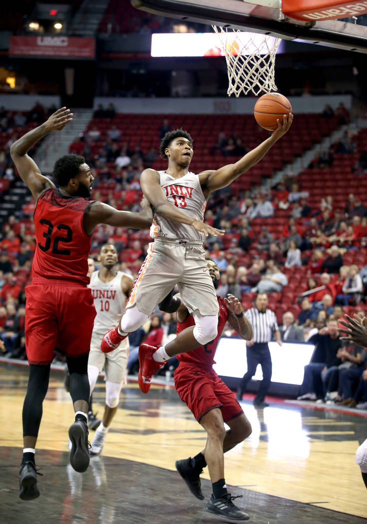 UNLV Rebels guard Bryce Hamilton (13) shoots past Southern Utah Thunderbirds forward Andre Adams (32) in the second half of their NCAA basketball game at the Thomas & Mack Center in Las Vegas ...