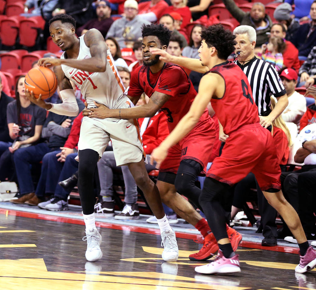 UNLV Rebels guard Kris Clyburn (1) is fouled by Southern Utah Thunderbirds guard Jason Richardson (3) in the second half of their NCAA basketball game at the Thomas & Mack Center in Las Vegas ...