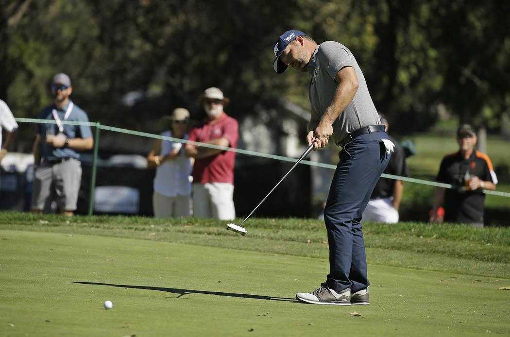 Ryan Moore putts on the second green of the Silverado Resort North Course during the final round of the Safeway Open PGA golf tournament Sunday, Oct. 7, 2018, in Napa, Calif. (AP Photo/Eric Risberg)