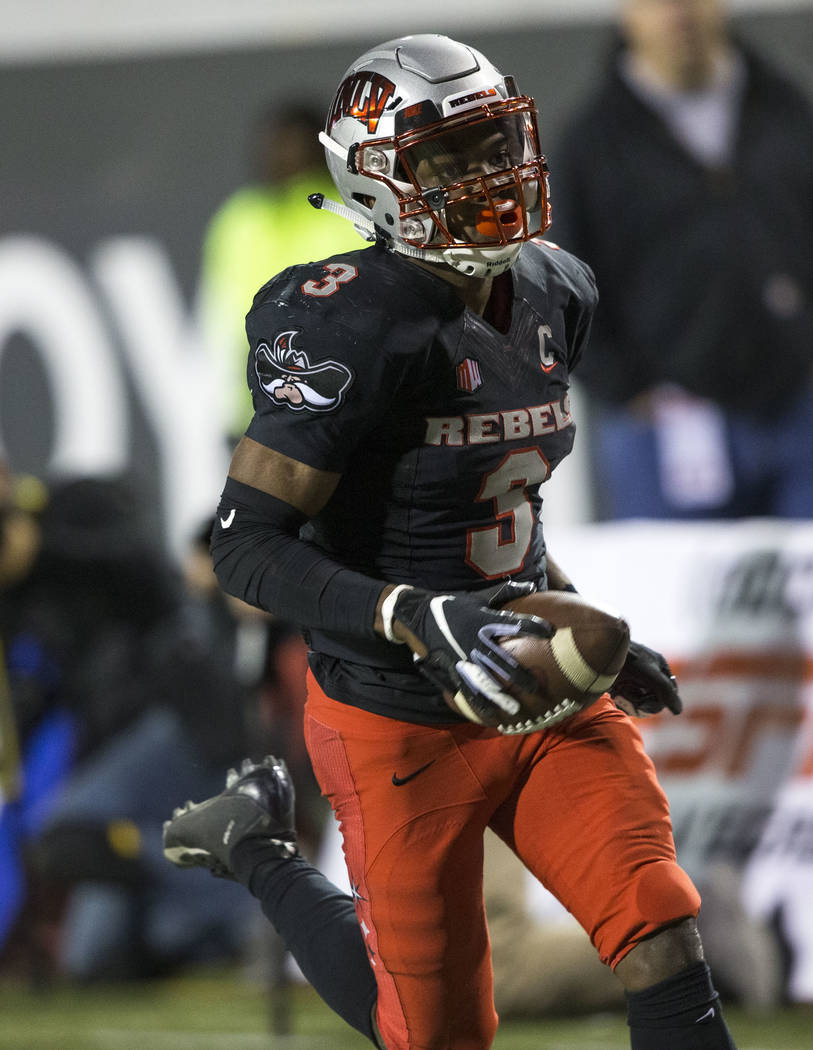 UNLV Rebels running back Lexington Thomas (3) runs for a touchdown against the Nevada Wolf Pack during the first half of an NCAA football game at Sam Boyd Stadium in Las Vegas on Saturday, Nov. 24 ...