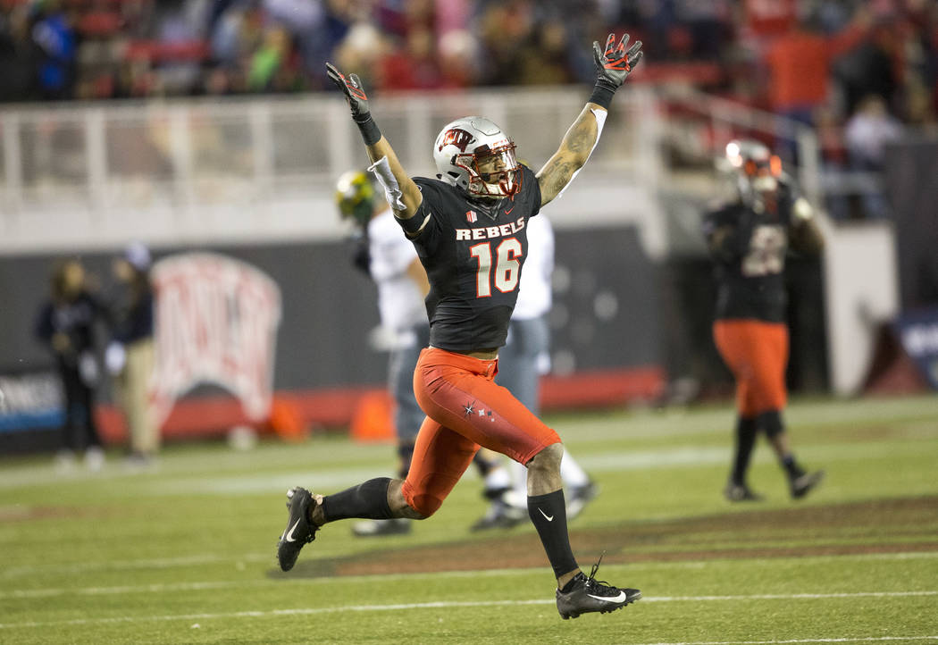 UNLV Rebels linebacker Javin White (16) celebrates his interceptions against the Nevada Wolf Pack during the second half of an NCAA football game at Sam Boyd Stadium in Las Vegas on Saturday, Nov. ...