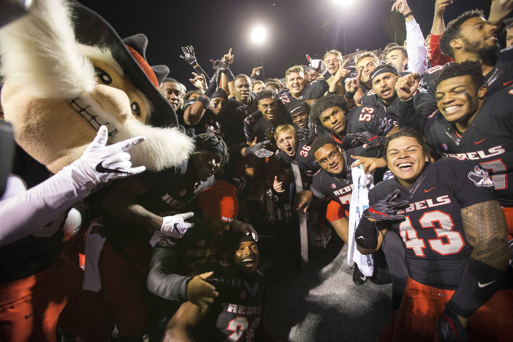 UNLV celebrates with the cannon after defeating the Nevada Wolf Pack 34-29 following an NCAA football game at Sam Boyd Stadium in Las Vegas on Saturday, Nov. 24, 2018. Richard Brian Las Vegas Revi ...