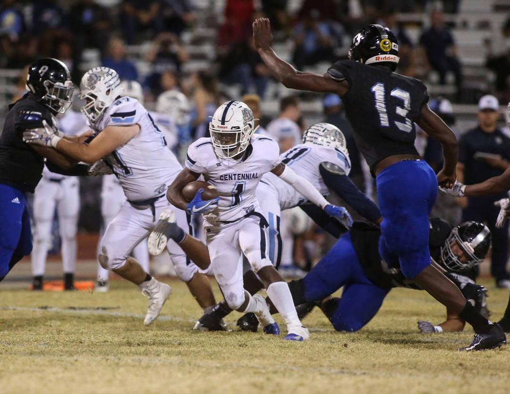 Centennial High School's Jordan Smith (1) runs with the ball during the second half of a varsity playoff football game at Desert Pines High School in Las Vegas, Friday, Nov. 2, 2018. Caroline Breh ...