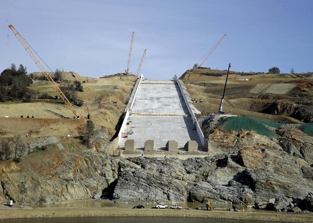 Crews work to repair the damaged main spillway of the Oroville Dam in Oroville, Calif., in November 2017. (AP Photo/Rich Pedroncelli)
