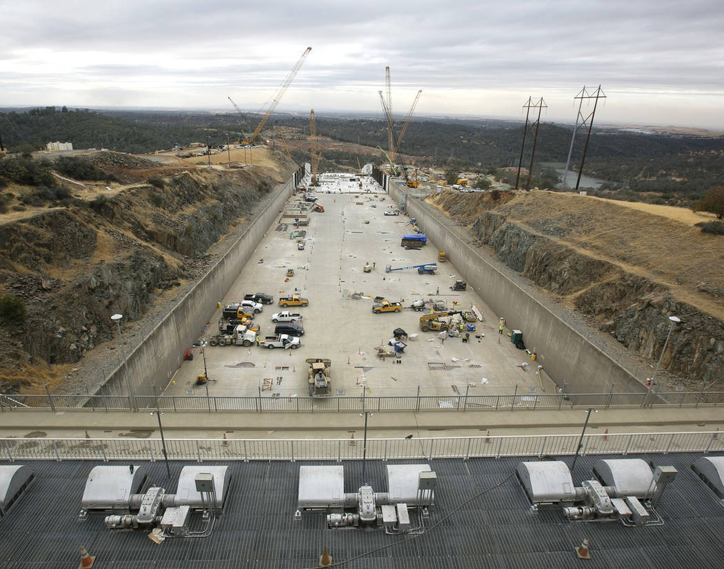Crews work to repair the damaged main spillway of the Oroville Dam in Oroville, Calif., in October 2017. (AP Photo/Rich Pedroncelli)
