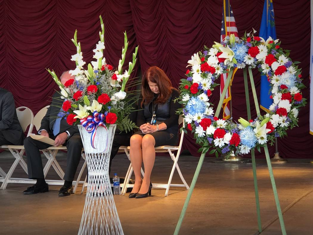 Henderson Mayor Debra March bows her head during the invocation at a Veteran's Day ceremony in Henderson on Saturday, Nov. 3, 2018. (Rio Lacanlale/Las Vegas Review-Journal)