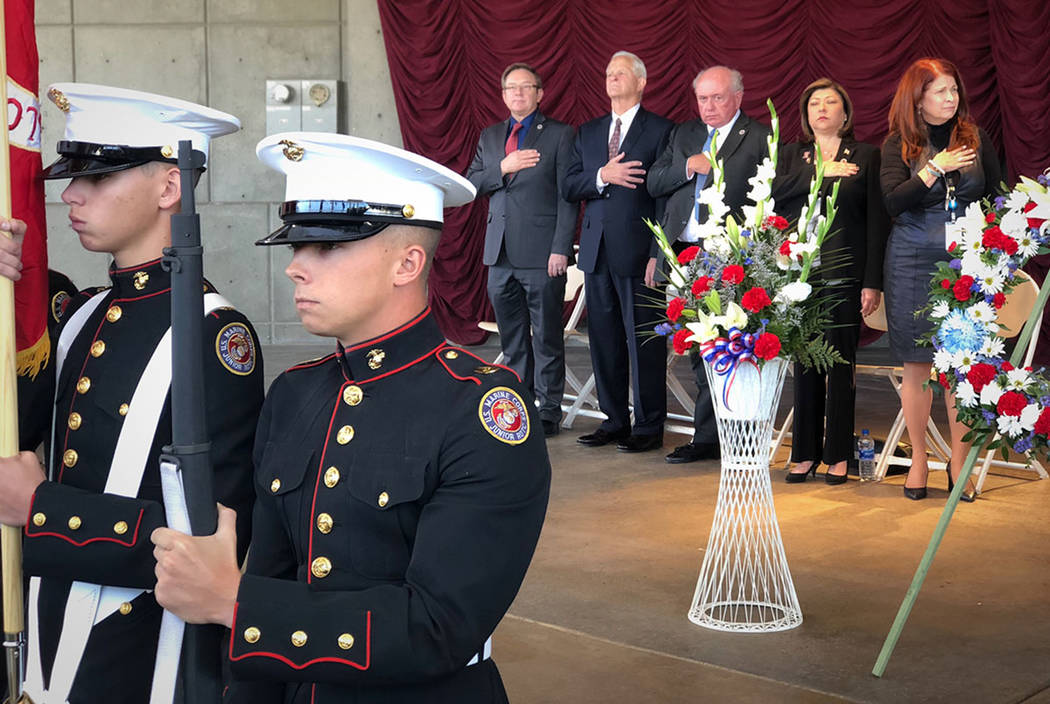 Henderson Mayor Debra March and members of the City Council stand for the Pledge of Allegiance following the Presentation of Colors by Basic High School's junior ROTC Color Guard during a Veteran' ...