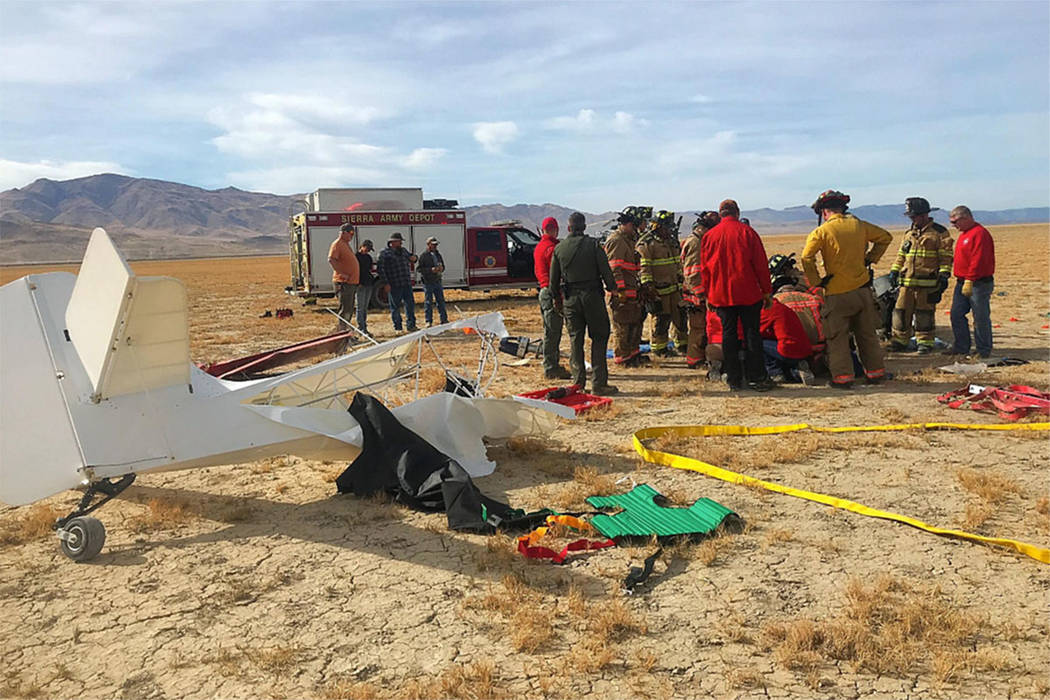 Crews work at the scene of a plane crash in the Fish Springs area, about 40 miles north of Reno, on Saturday, Nov. 3, 2018. (Washoe County Sheriff's Office)
