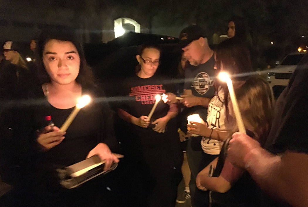 Mourners gather to remember Angelina Erives during a vigil Saturday, Nov. 3, 2018, on Courtney Michelle Street in Las Vegas. (Kimber Laux/Las Vegas Review-Journal)