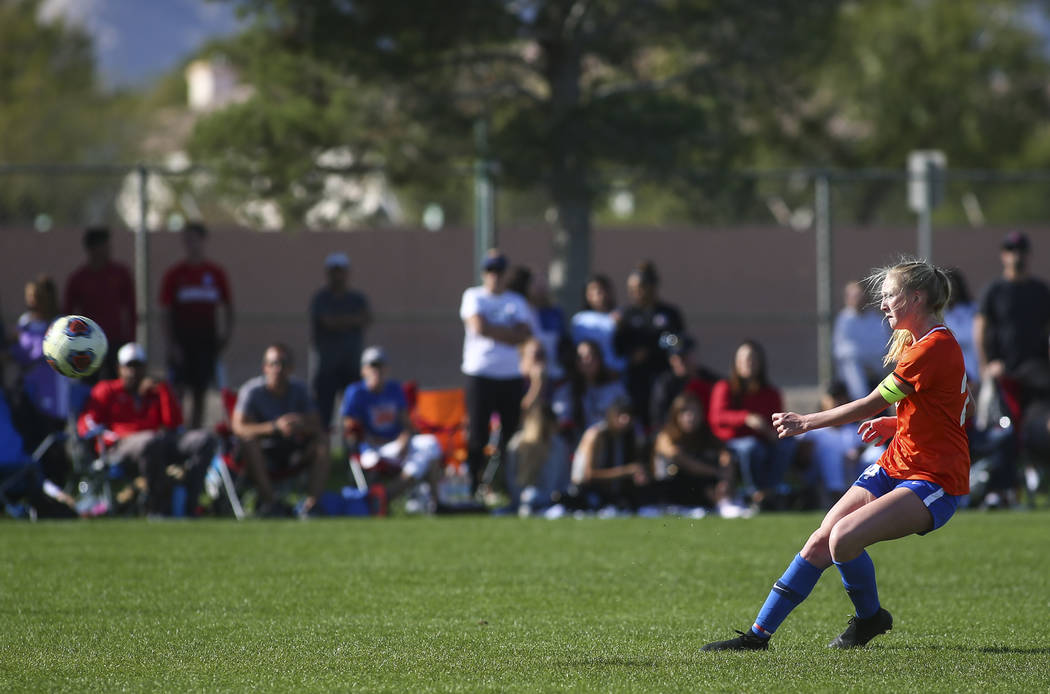 Bishop Gorman's Kevyn Hillegas (24) kicks the ball to score past Coronado's Taylor Book, not pictured, to score the first goal during the Desert Region girls soccer championship game at Bettye Wil ...