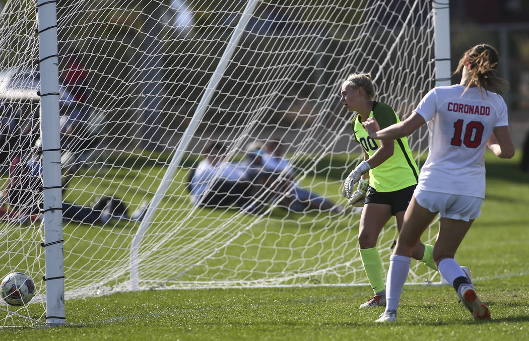 Coronado's Taylor Book gives up a goal to Bishop Gorman's Kevyn Hillegas (24) during the Desert Region girls soccer championship game at Bettye Wilson Soccer Complex in Las Vegas on Saturday, Nov. ...
