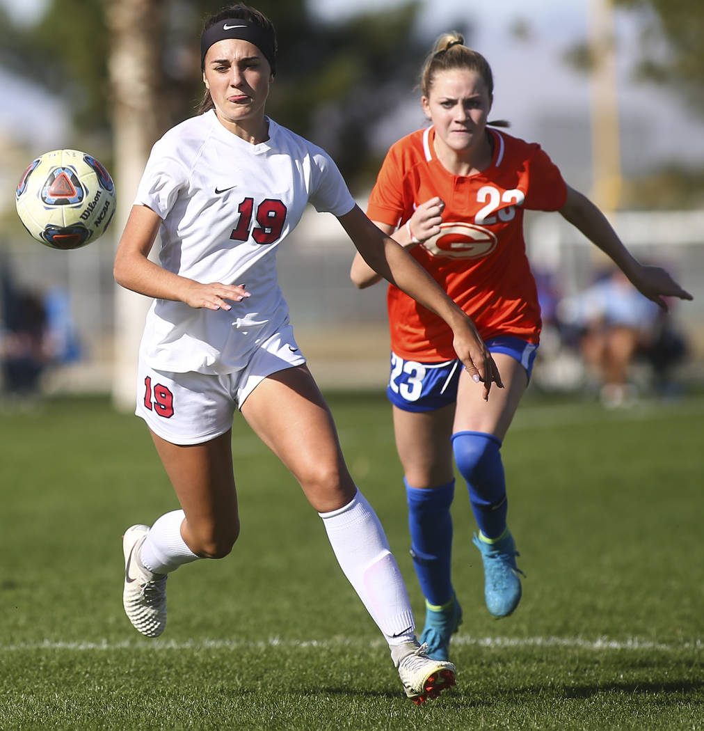Coronado's Simone Hottentot chases after the ball against Bishop Gorman's Jacqueline Hillegas (23) during the Desert Region girls soccer championship game at Bettye Wilson Soccer Complex in Las Ve ...