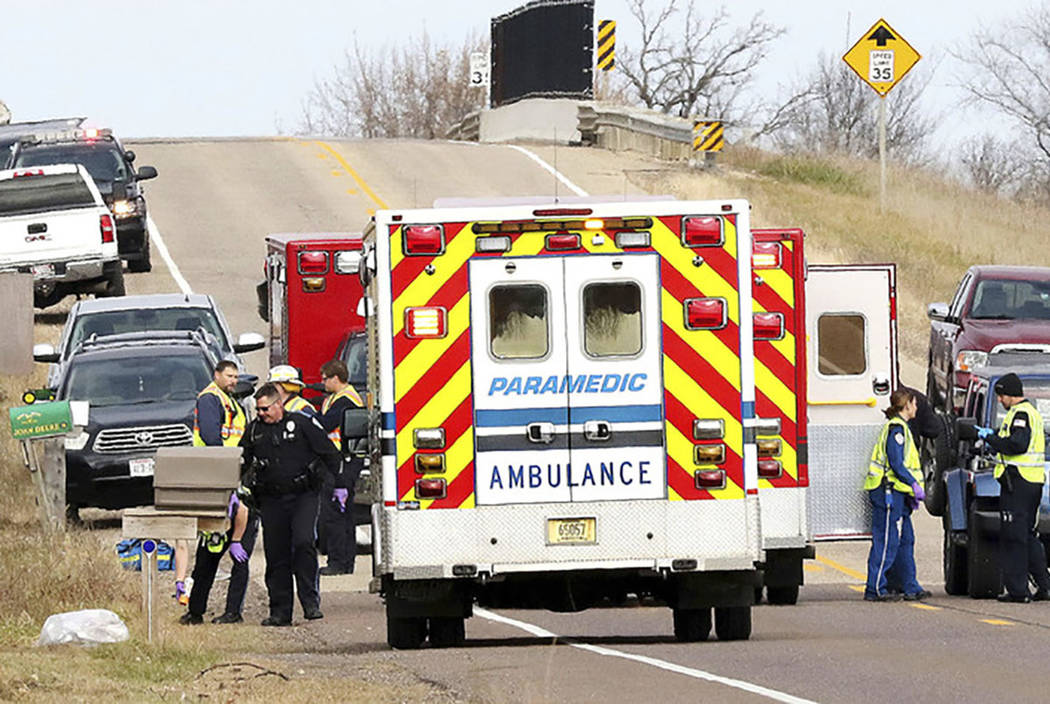 Emergency medical personnel gather at the scene of a hit-and-run accident Saturday, Nov. 3, 2018, in Lake Hallie, Wis., that killed two girls and an adult. (Steve Kinderman/The Eau Claire Leader-T ...