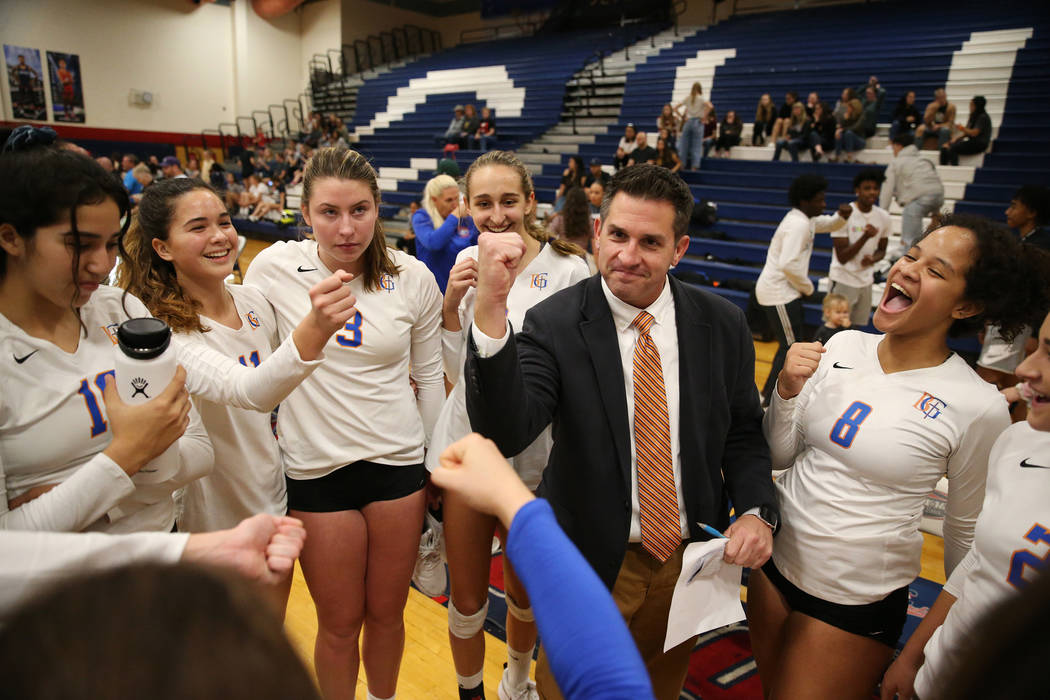 Bishop Gorman coach Gregg Nunley, center, celebrates with his team after their victory 3-0 against Palo Verde in the girl's volleyball game at Coronado High School in Henderson, Saturday, Nov. 3, ...