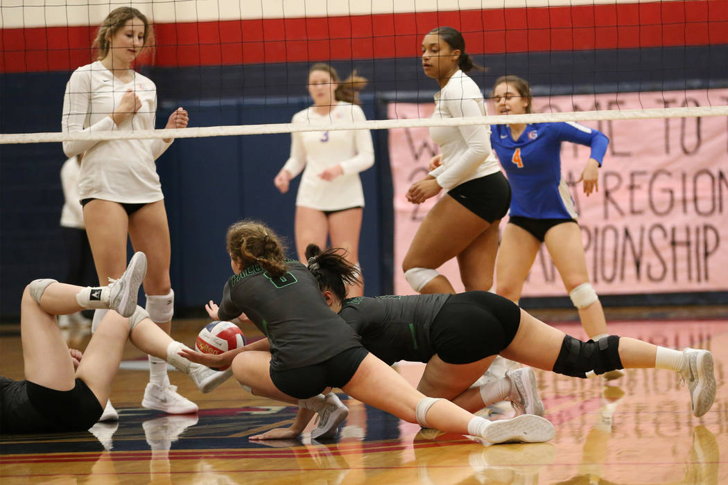 Palo Verde players dive as the ball drops for a point for Bishop Gorman during the third set of the girl's volleyball game at Coronado High School in Henderson, Saturday, Nov. 3, 2018. Bishop Gorm ...