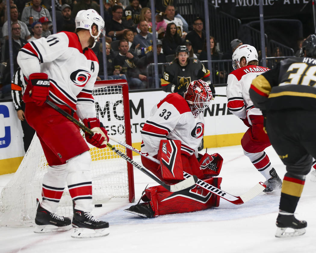 Golden Knights defenseman Brad Hunt, not pictured, sends in a shot past Carolina Hurricanes goaltender Scott Darling (33) to score a goal during the first period of an NHL hockey game at T-Mobile ...