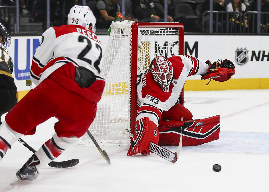 Carolina Hurricanes goaltender Scott Darling (33) blocks a shot from the Golden Knights during the first period of an NHL hockey game at T-Mobile Arena in Las Vegas on Saturday, Nov. 3, 2018. Chas ...