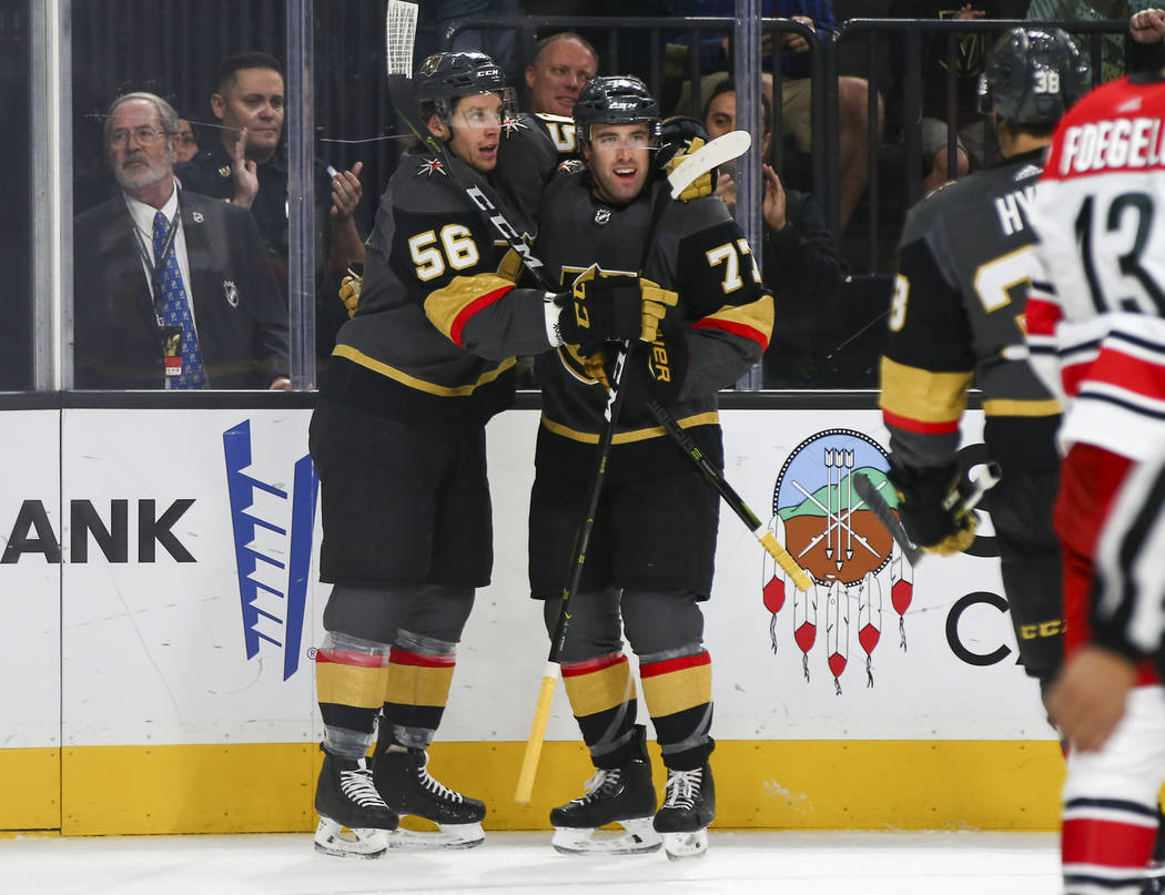 Golden Knights defenseman Brad Hunt (77) celebrates his goal against the Carolina Hurricanes with Golden Knights center Erik Haula (56) during the first period of an NHL hockey game at T-Mobile Ar ...
