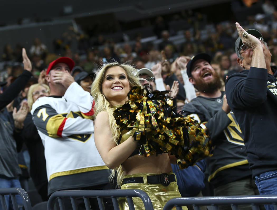 A Golden Aces cheerleader celebrates the second goal by the Golden Knights during the second period of an NHL hockey game against the Carolina Hurricanes at T-Mobile Arena in Las Vegas on Saturday ...