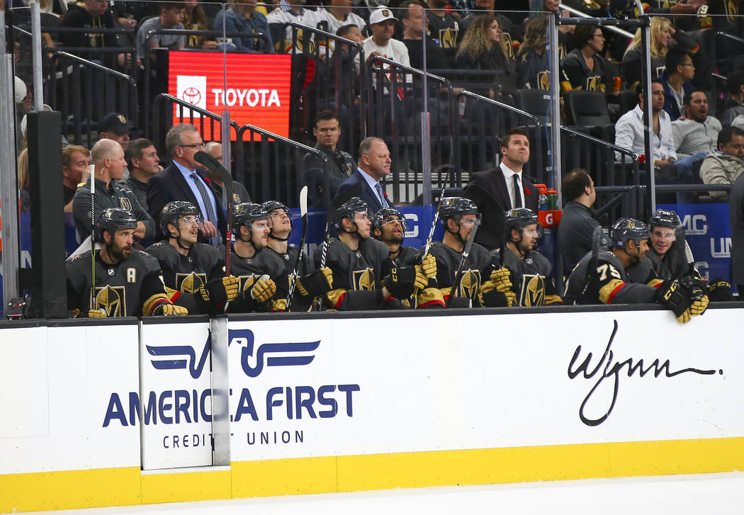 Golden Knights players take in the action from the bench during the second period of an NHL hockey game against the Carolina Hurricanes at T-Mobile Arena in Las Vegas on Saturday, Nov. 3, 2018. Ch ...