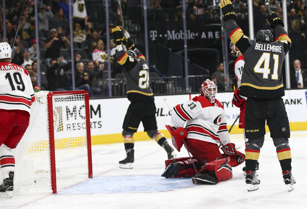 Golden Knights center Pierre-Edouard Bellemare (41) celebrates a goal by Golden Knights left wing William Carrier (28) against the Carolina Hurricanes during the third period of an NHL hockey game ...