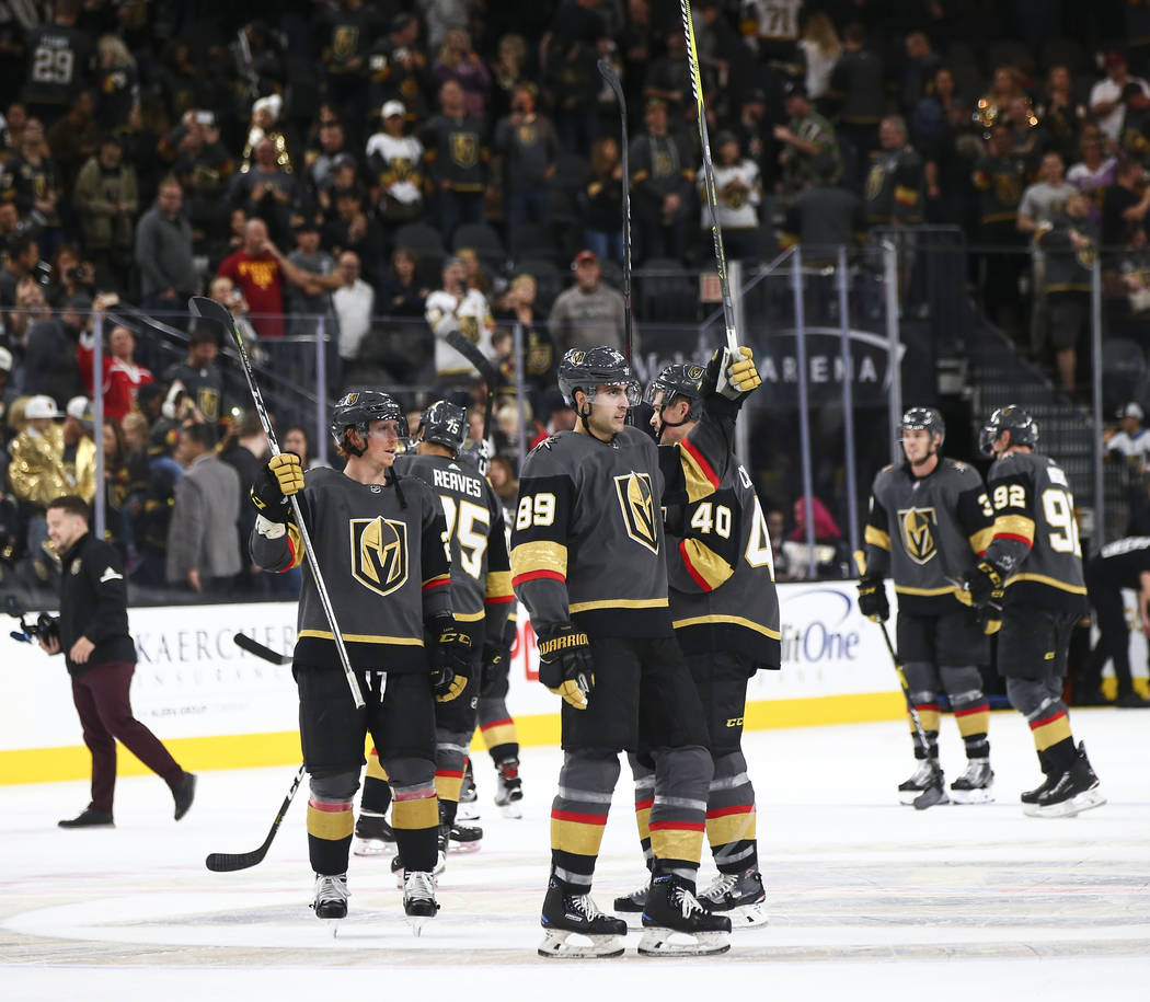 Golden Knights players celebrate after the team won 3-0 over the Carolina Hurricanes in an NHL hockey game at T-Mobile Arena in Las Vegas on Saturday, Nov. 3, 2018. Chase Stevens Las Vegas Review- ...