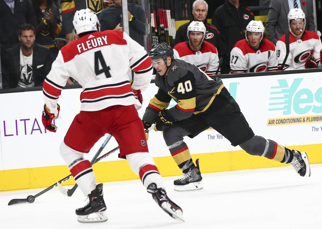 Golden Knights center Ryan Carpenter (40) moves the puck against Carolina Hurricanes defenseman Haydn Fleury (4) during the third period of an NHL hockey game at T-Mobile Arena in Las Vegas on Sat ...