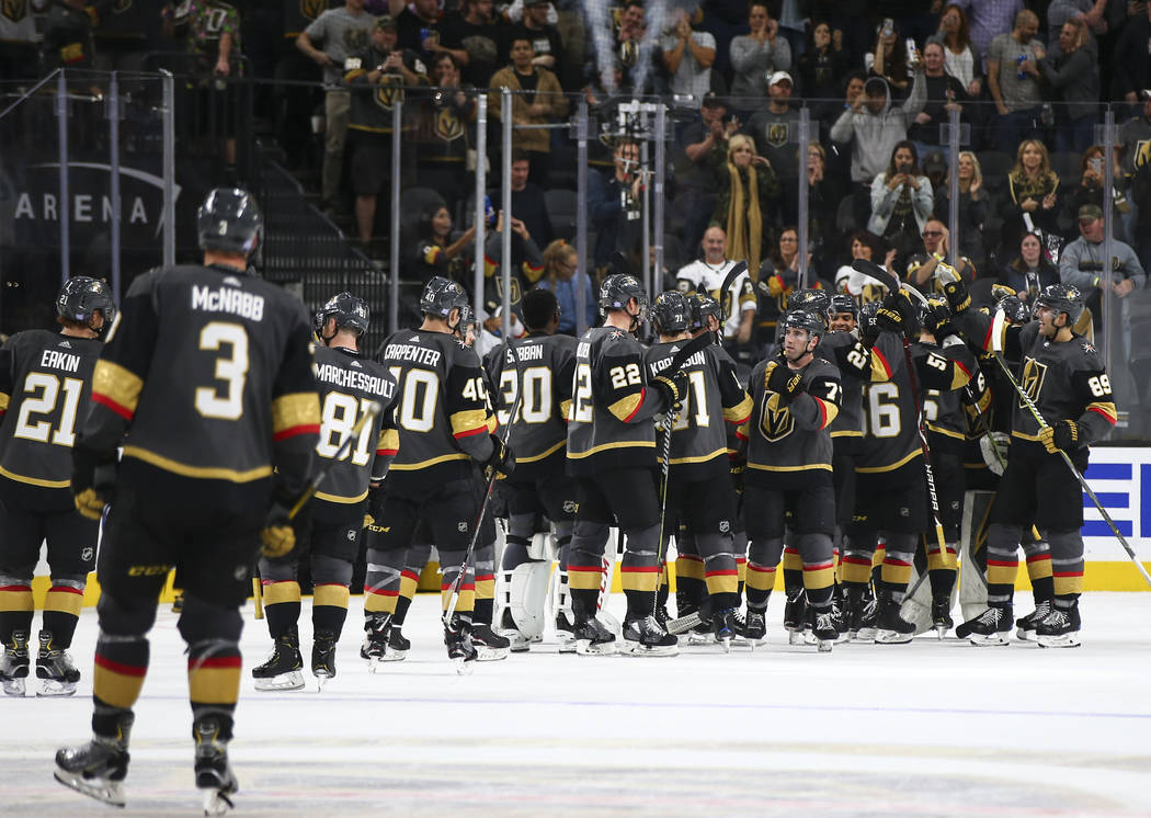 Golden Knights players surround Golden Knights goaltender Marc-Andre Fleury (29) after the team won 3-0 over the Carolina Hurricanes in an NHL hockey game at T-Mobile Arena in Las Vegas on Saturda ...