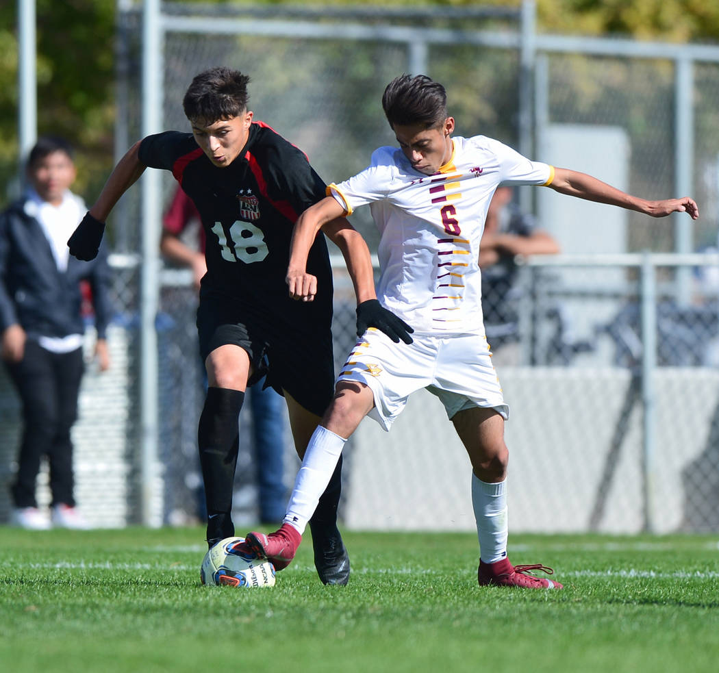 Eldorado High School's Jesus Espejo (6) challenges Las Vegas High School's Sergio Aguayo (18) for the ball in the second half of the 3A Mountain Region Championship soccer game between Las Vegas H ...