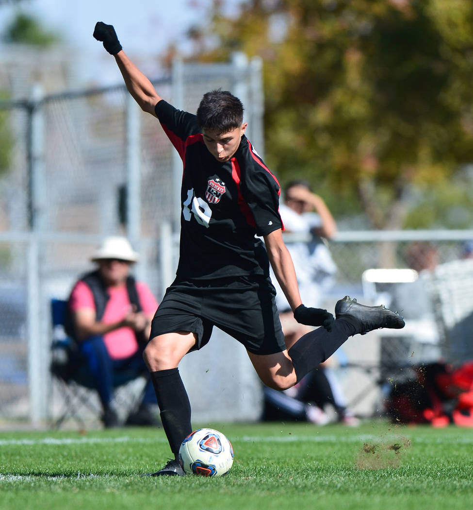 Las Vegas High School's Sergio Aguayo (18) kicks the winning goal in the second half of the 3A Mountain Region Championship soccer game between Las Vegas High School and Eldorado High School in L ...