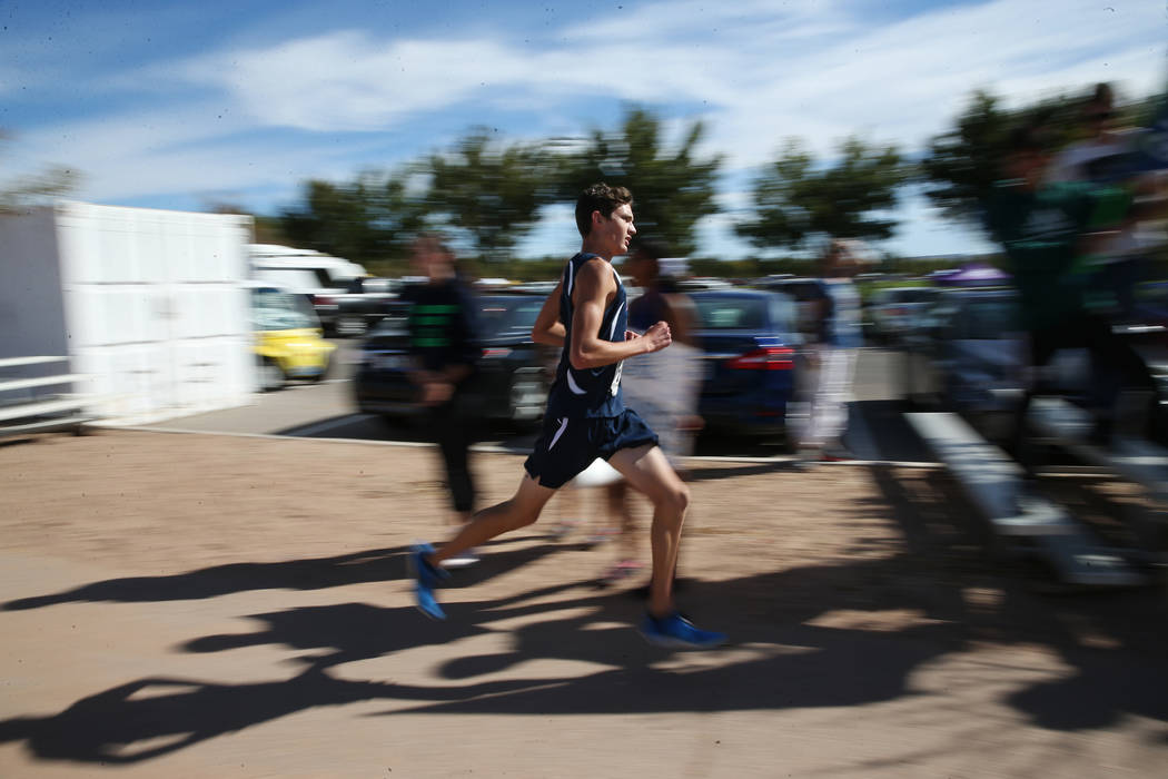 A runner competes during the NIAA 4A Boys Cross Country State Championship at the Veteran's Memorial Park in Boulder City, Saturday, Nov. 3, 2018. Erik Verduzco Las Vegas Review-Journal @Erik_Verduzco