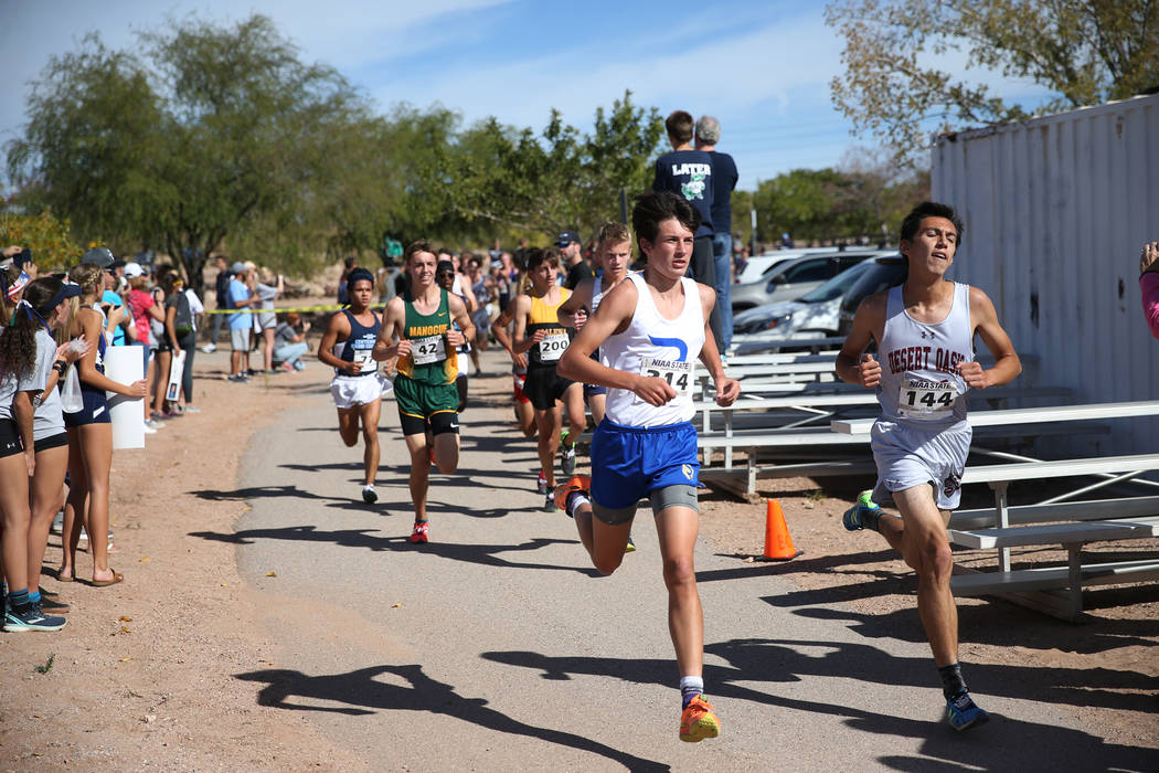 Runners compete during the NIAA 4A Boys Cross Country State Championship at the Veteran's Memorial Park in Boulder City, Saturday, Nov. 3, 2018. Erik Verduzco Las Vegas Review-Journal @Erik_Verduzco