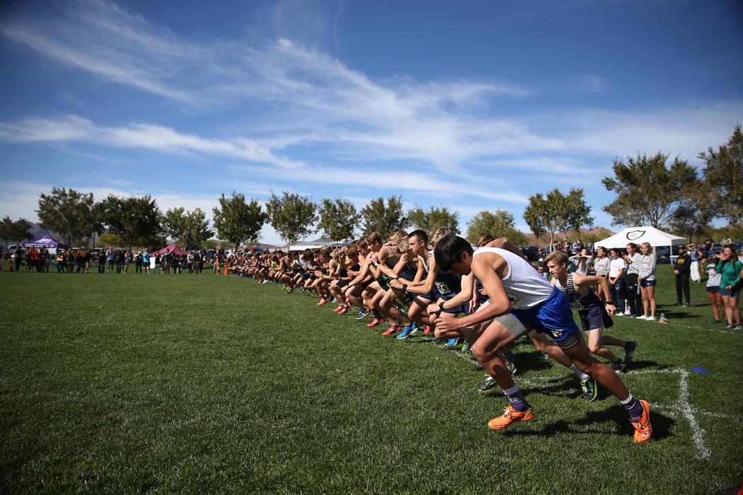 Runners start during the NIAA 4A Boys Cross Country State Championship at the Veteran's Memorial Park in Boulder City, Saturday, Nov. 3, 2018. Erik Verduzco Las Vegas Review-Journal @Erik_Verduzco