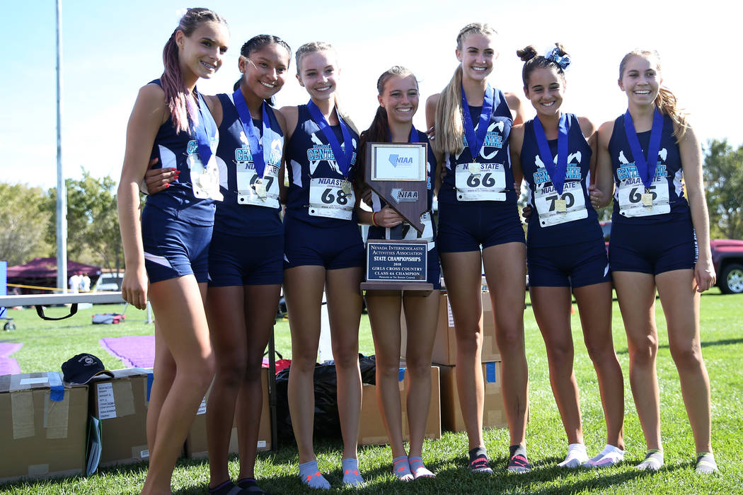 Centennial celebrate first team place in the NIAA 4A Girls Cross Country State Championship at the Veteran's Memorial Park in Boulder City, Saturday, Nov. 3, 2018. Erik Verduzco Las Vegas Review-J ...