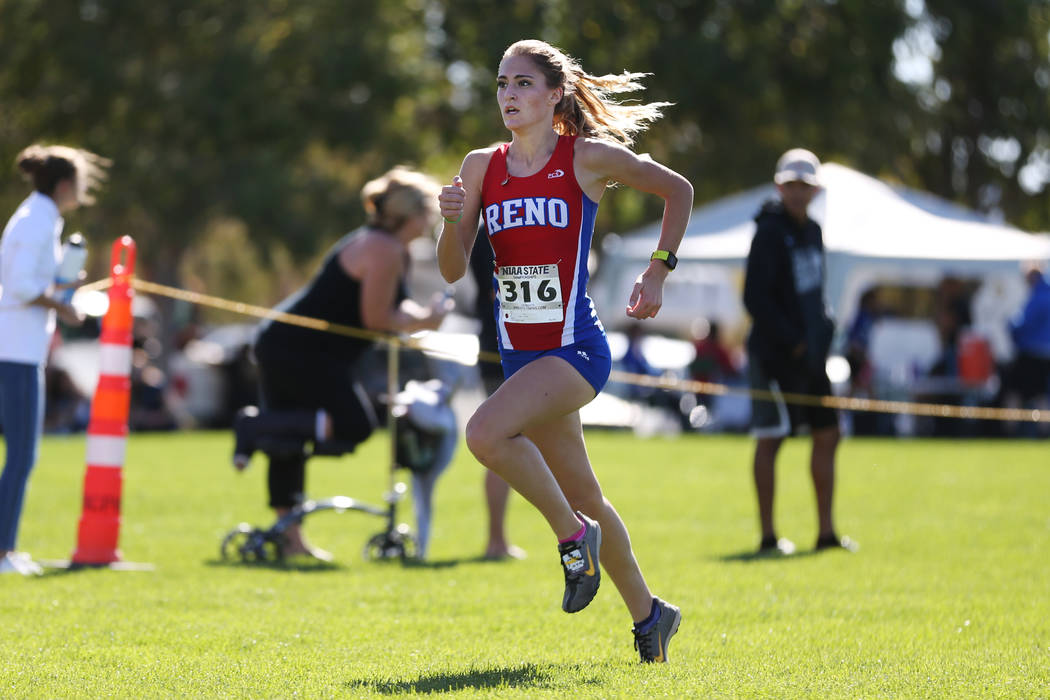 Reno's Penelope Smerdon (316) makes her way to the finish line for second place during the NIAA 4A Girls Cross Country State Championship at the Veteran's Memorial Park in Boulder City, Saturday, ...