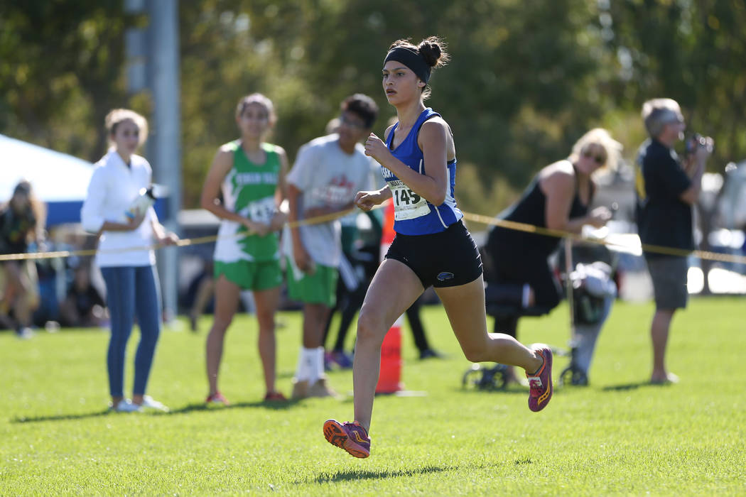 Desert Pines Jazmin Felix (145) makes her way to the finish line for first place during the NIAA 4A Girls Cross Country State Championship at the Veteran's Memorial Park in Boulder City, Saturday, ...