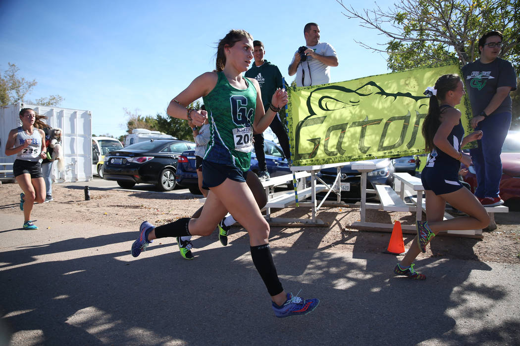 Green Valley's Mia Smith, 17, center, competes in the NIAA 4A Girls Cross Country State Championship at the Veteran's Memorial Park in Boulder City, Saturday, Nov. 3, 2018. Smith finished 15 overa ...