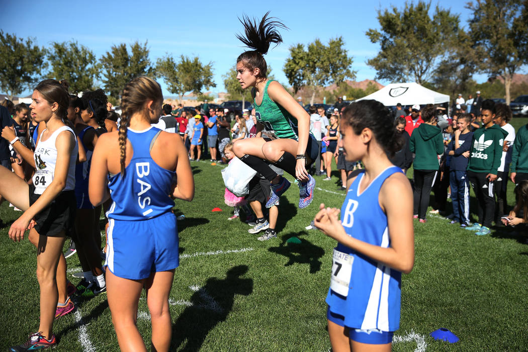 Green Valley's Mia Smith, 17, center, warms-up to compete in the NIAA 4A Girls Cross Country State Championship at the Veteran's Memorial Park in Boulder City, Saturday, Nov. 3, 2018. Smith finish ...