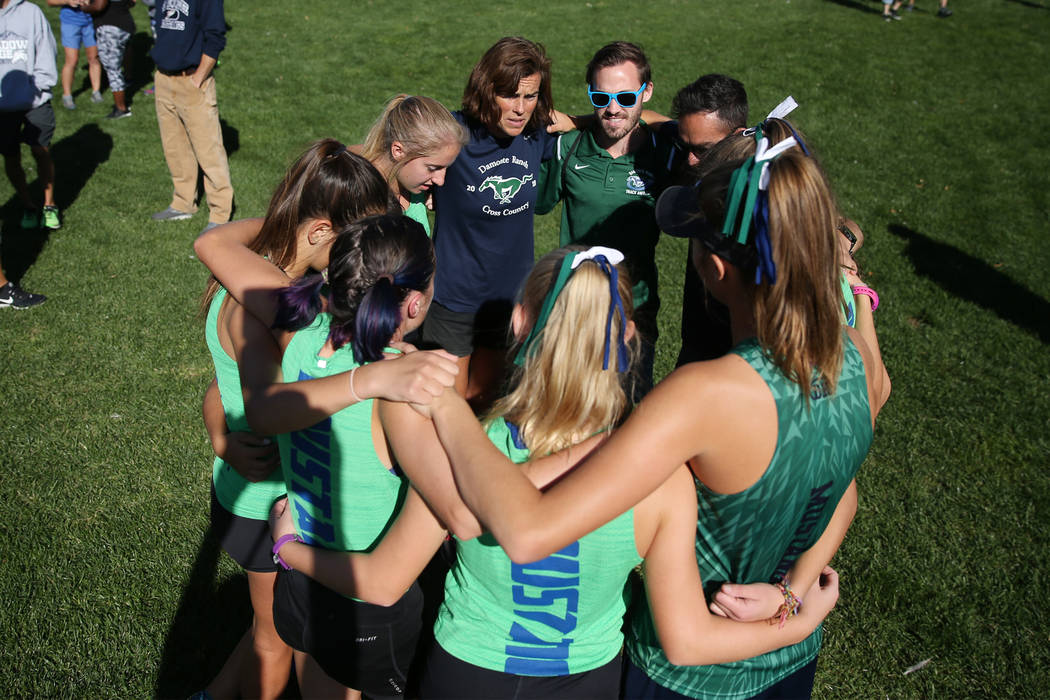 Damonte Ranch runners huddle before competing in the NIAA 4A Girls Cross Country State Championship at the Veteran's Memorial Park in Boulder City, Saturday, Nov. 3, 2018. Erik Verduzco Las Vegas ...